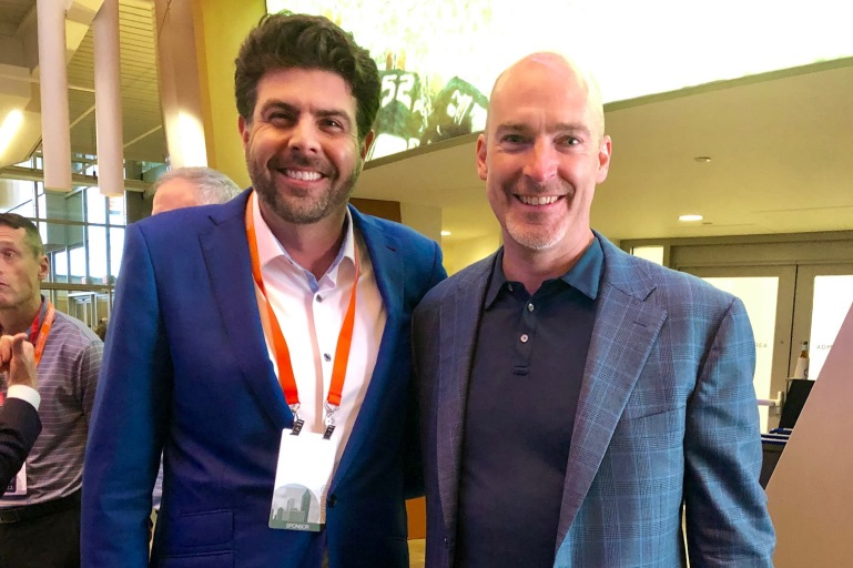 Alec Broadfoot and Gino Wickman at 2019 Conference for Companies Running on EOS